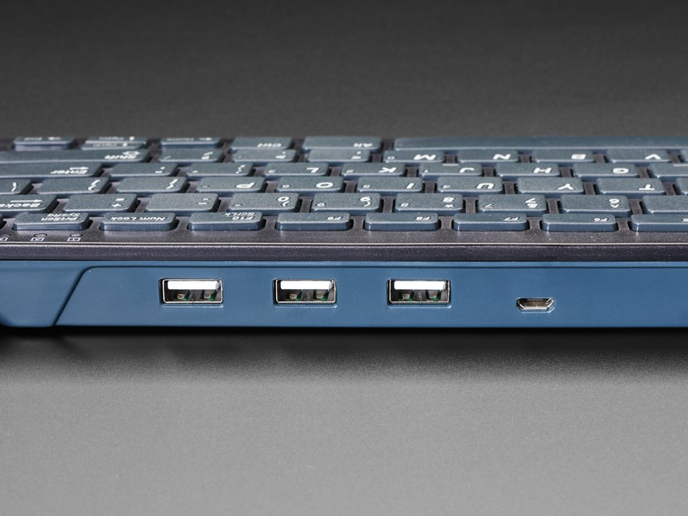 Close up shot of the USB hub built in to the front of the keyboard.