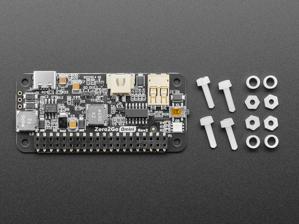 Kit shot of the Zero2Go Omini – Multi-Channel Power Supply for Raspberry Pi with four standoffs, screws, and spacers