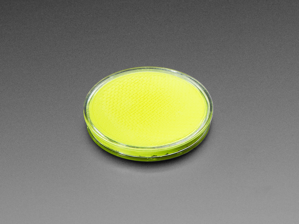 round yellow disc of fluorescent paint.