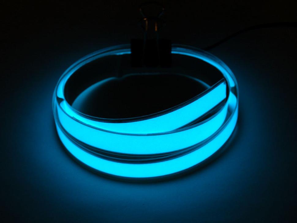 Coil of lit Aqua Electroluminescent Tape Strip