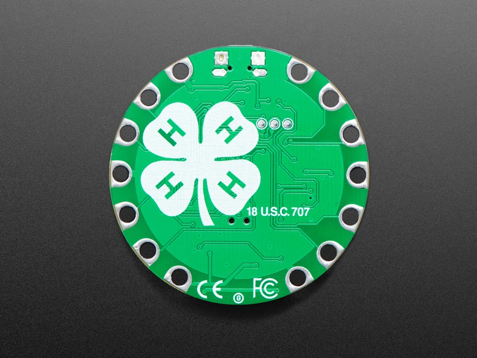 Back of round green dev board with the 4-H logo in white.