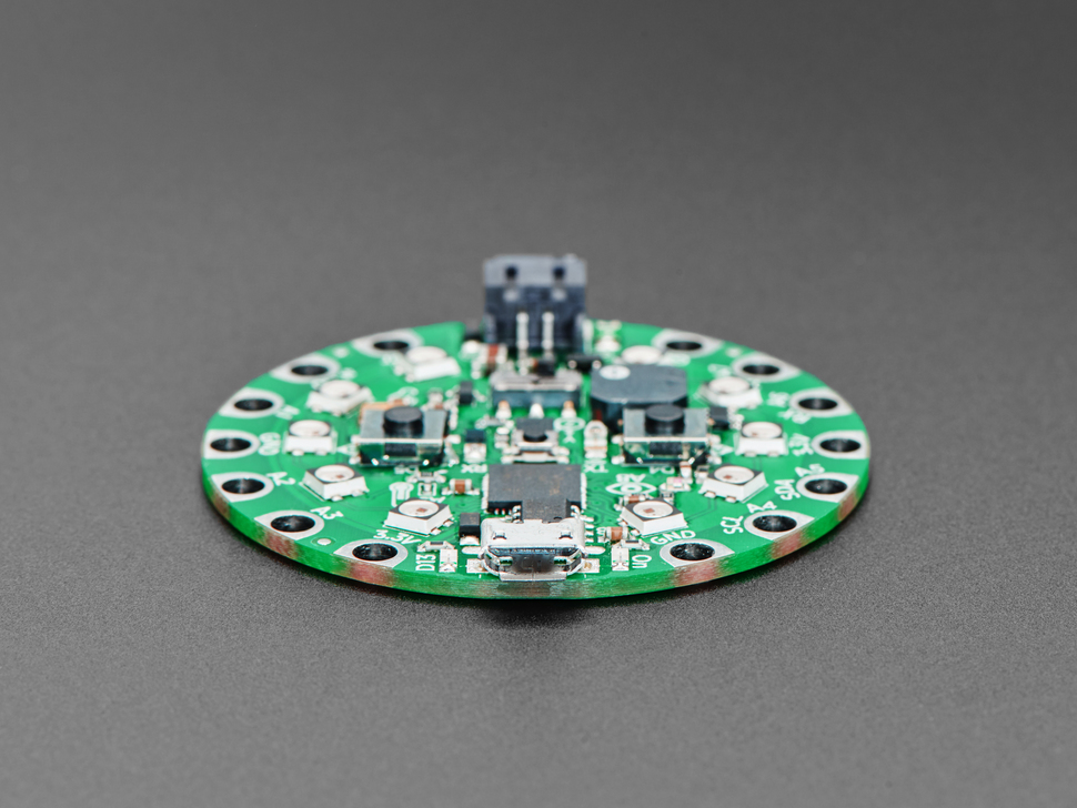 close-up of round green dev board featuring the microUSB connector.