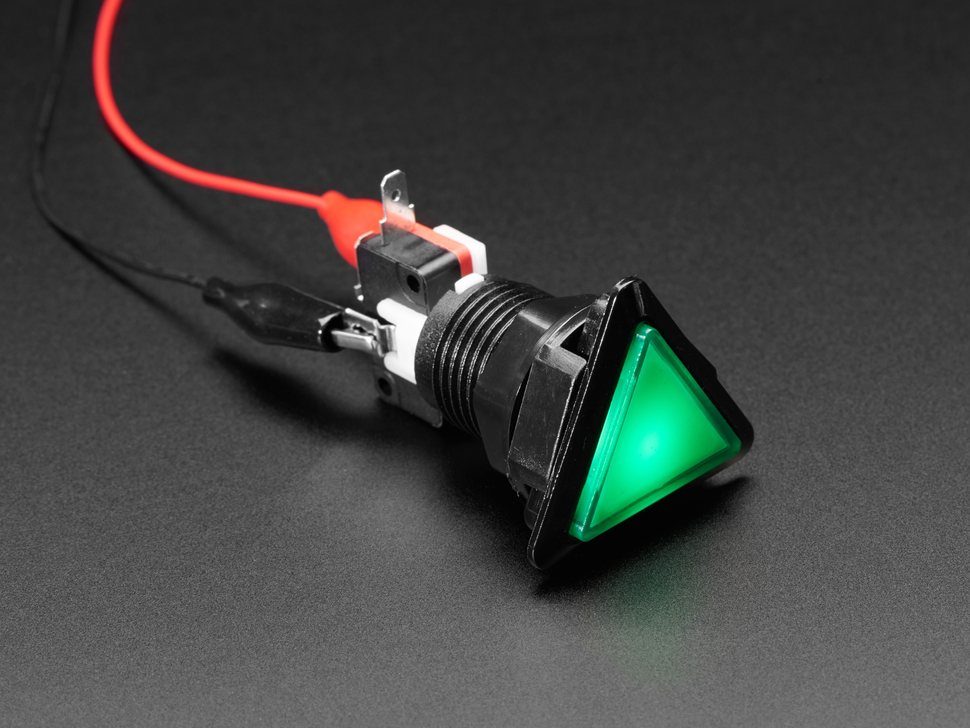 Angled shot of a green triangle illuminated LED pushbutton.
