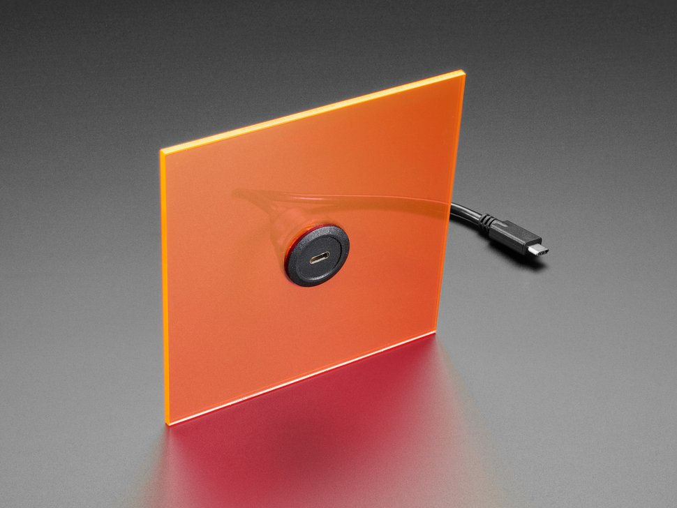 Shot of round panel mounted on an orange square.