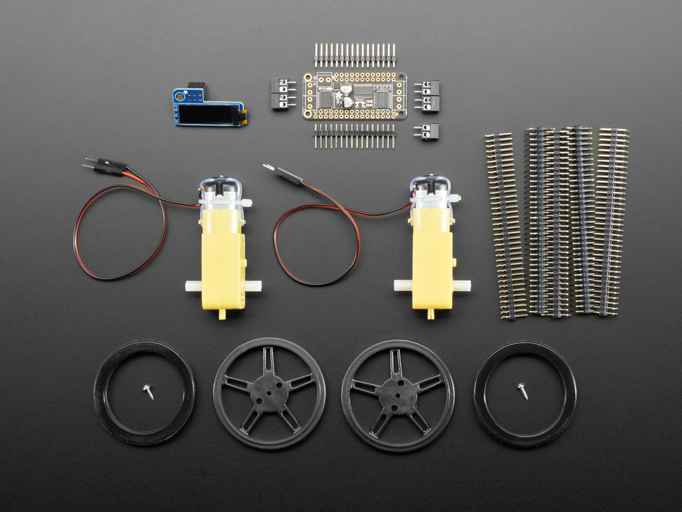 Kit component shot with wheels, motors and other hardware.