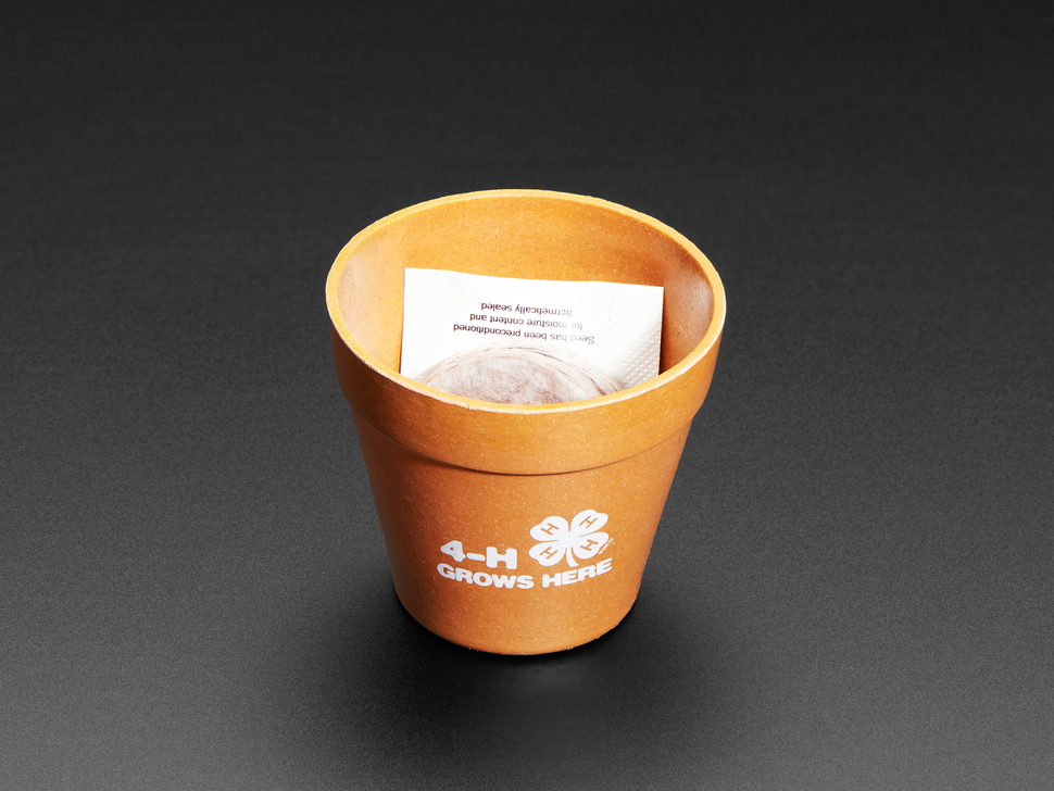 planter with seed packet inside