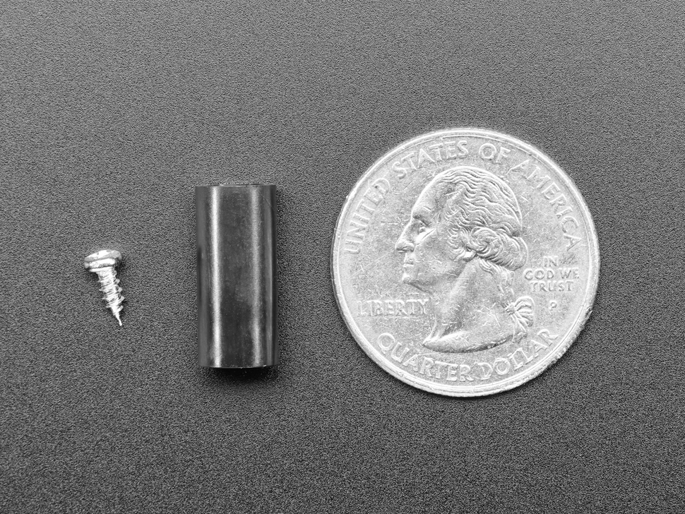 Profile of adapter and mounting screw, next to quarter