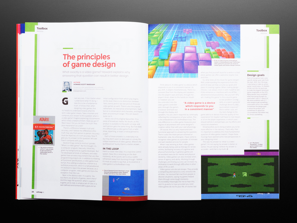 open magazine spread featuring article on the principles of game design.