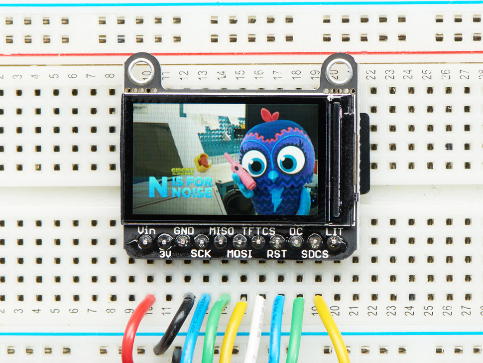 TFT breakout wired up on breadboard, showing colorful image of friendly owl