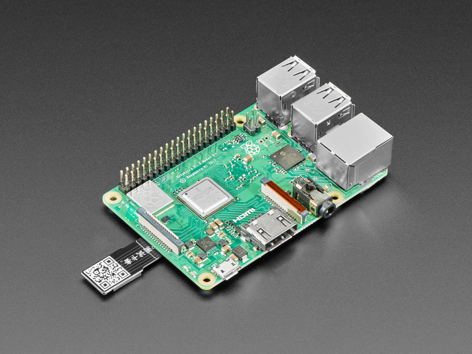 Micro SD Card PCB Extender plugged into upright Raspberry Pi