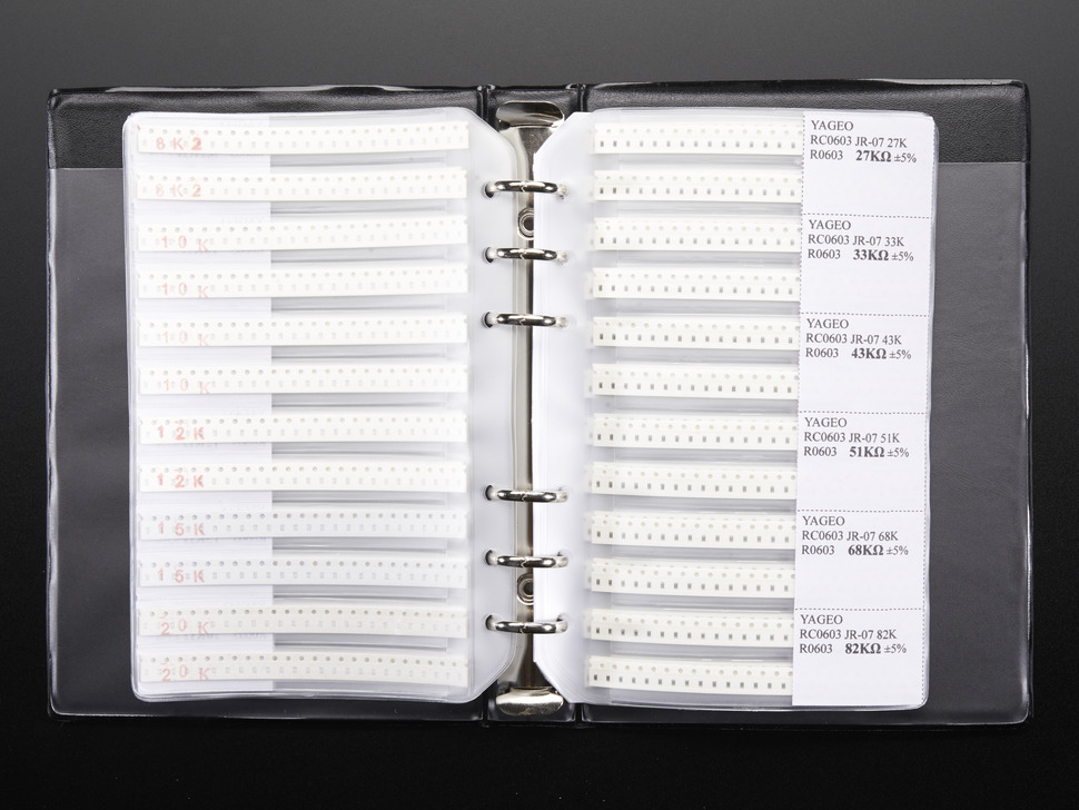 Opened book of cut tape resistors in loose-leaf storage pages