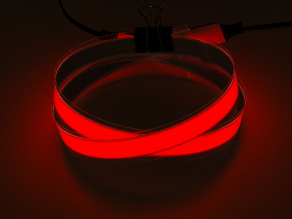 Coil of lit red Electroluminescent Tape Strip