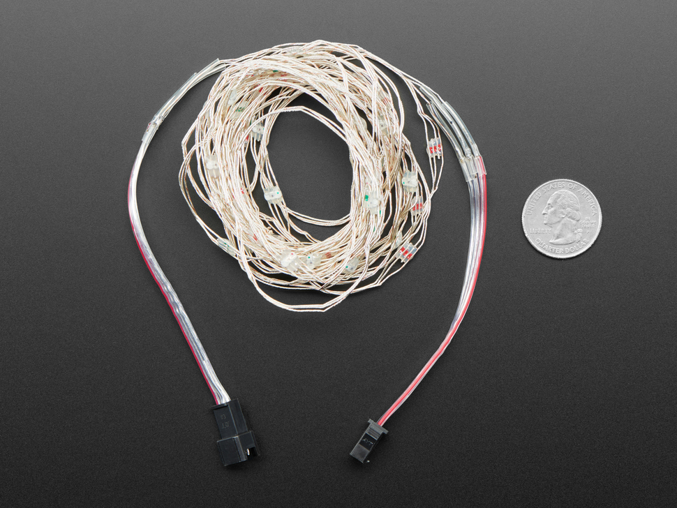 Adafruit Soft Flexible Wire NeoPixel Strand, coiled up next to quarter