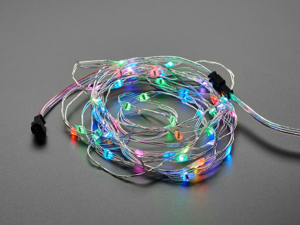 Adafruit Soft Flexible Wire NeoPixel Strand, coiled up and lit in rainbows
