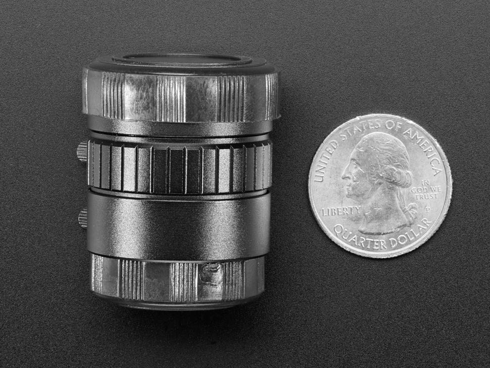 Profile of lens next to quarter
