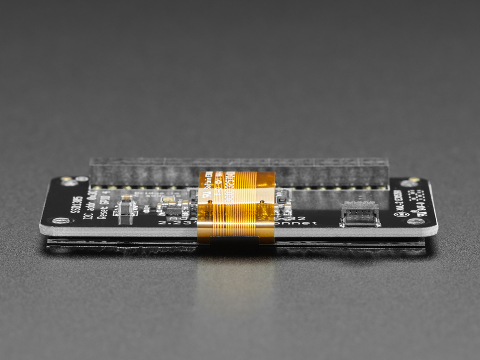 Side shot of OLED display PCB featuring display ribbon cable.