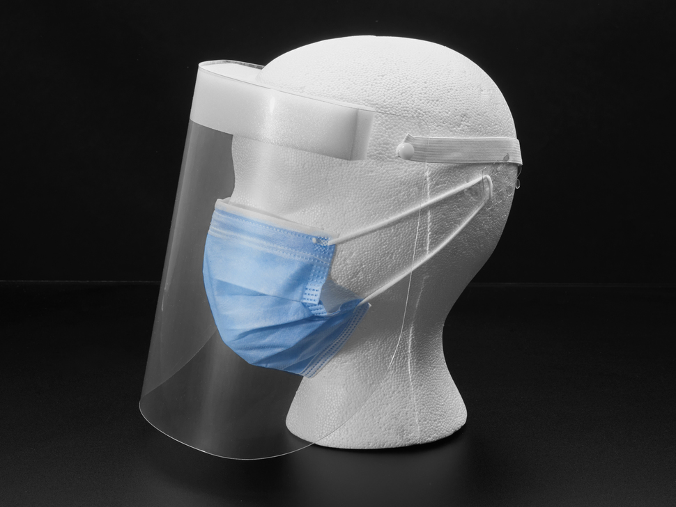 Side profile of the face shield on a mannequin head.