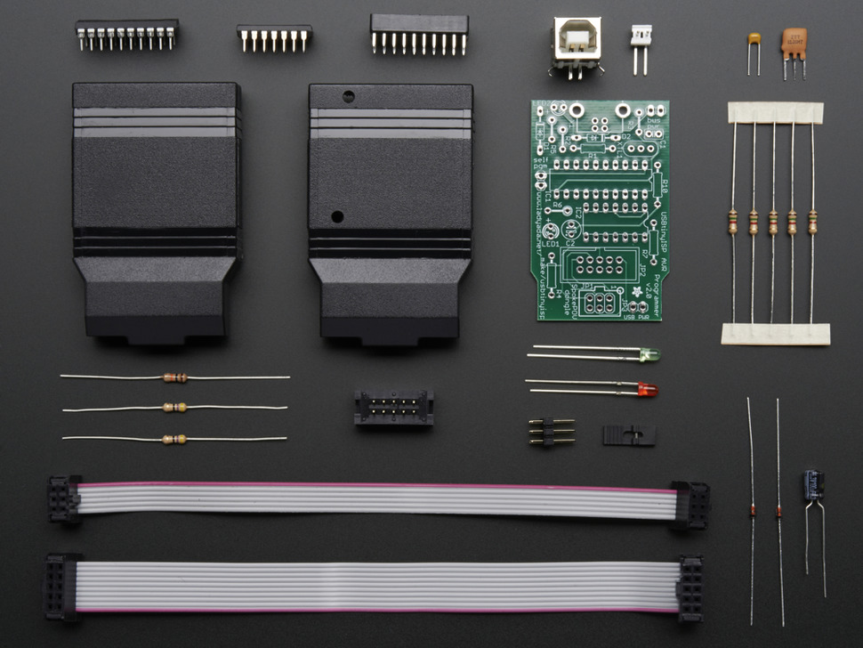 Layed-out collection of kit components - PCB and loose parts.