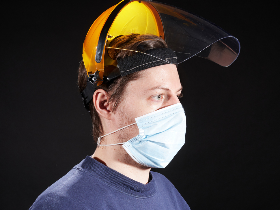 Face mask shown being worn and flipped up