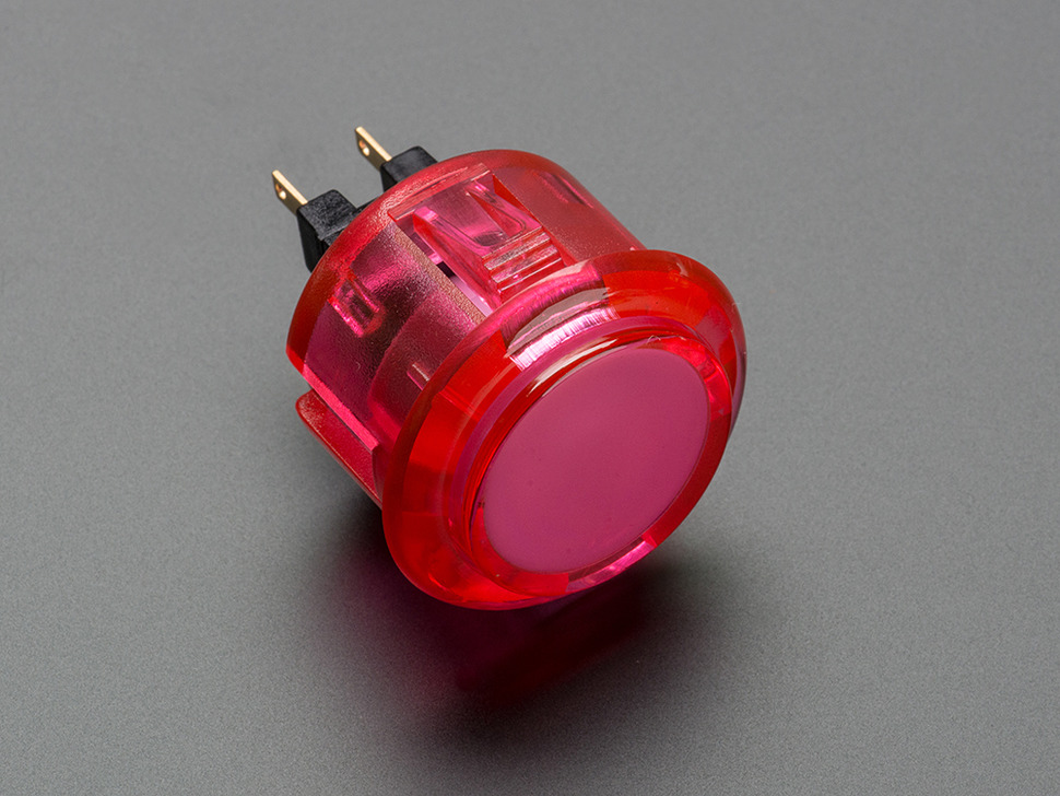 Angled shot of a pink translucent round 30mm arcade button.