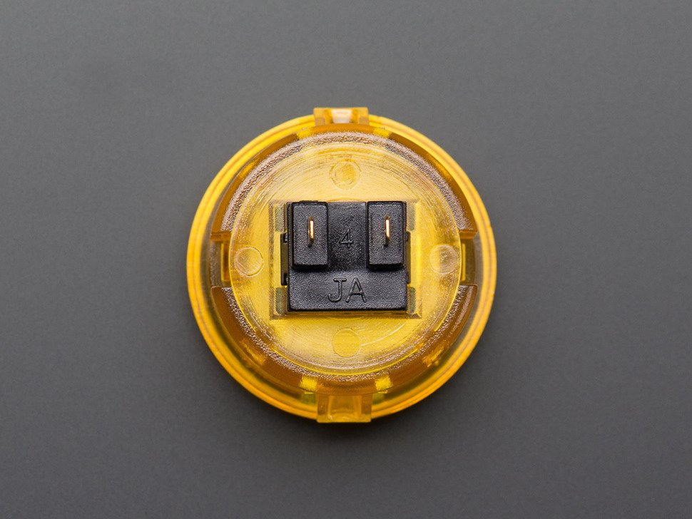 Back of arcade button featuring two leads.