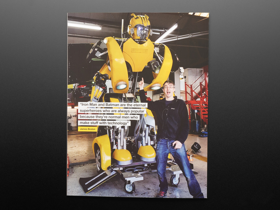 Back of Hackspace magazine featuring a towering yellow mecha-robot next to an adult white man in jeans and a black sweater. He faces the reader and points a finger towards the yellow mecha-robot. The man's expression reads excitement and accomplishment.