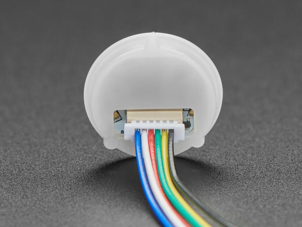 Back-side of round fingerprint sensor.