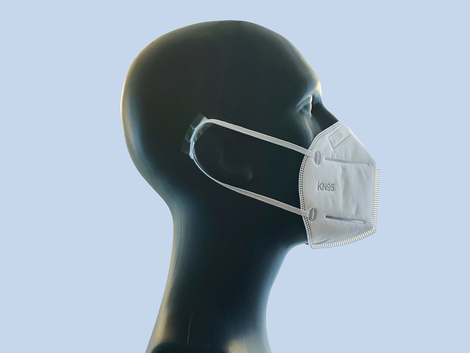 Profile of a mannequin wearing a K95 mask