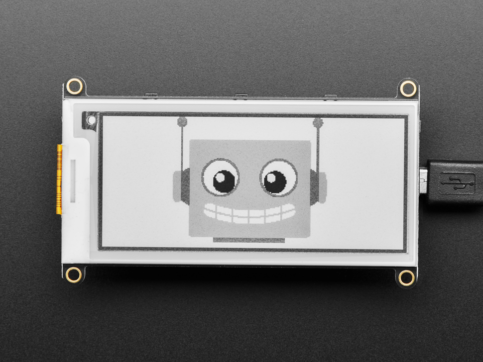 E-Ink display connected to Feather,  with image of friendly robot