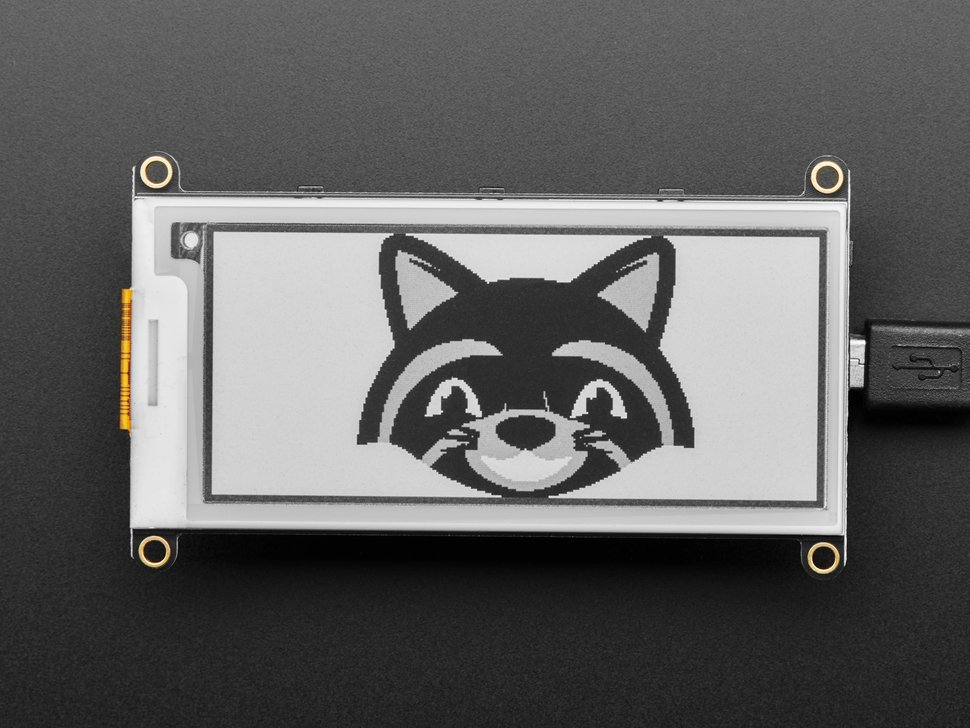 E-Ink display connected to Feather,  with image of friendly raccoon
