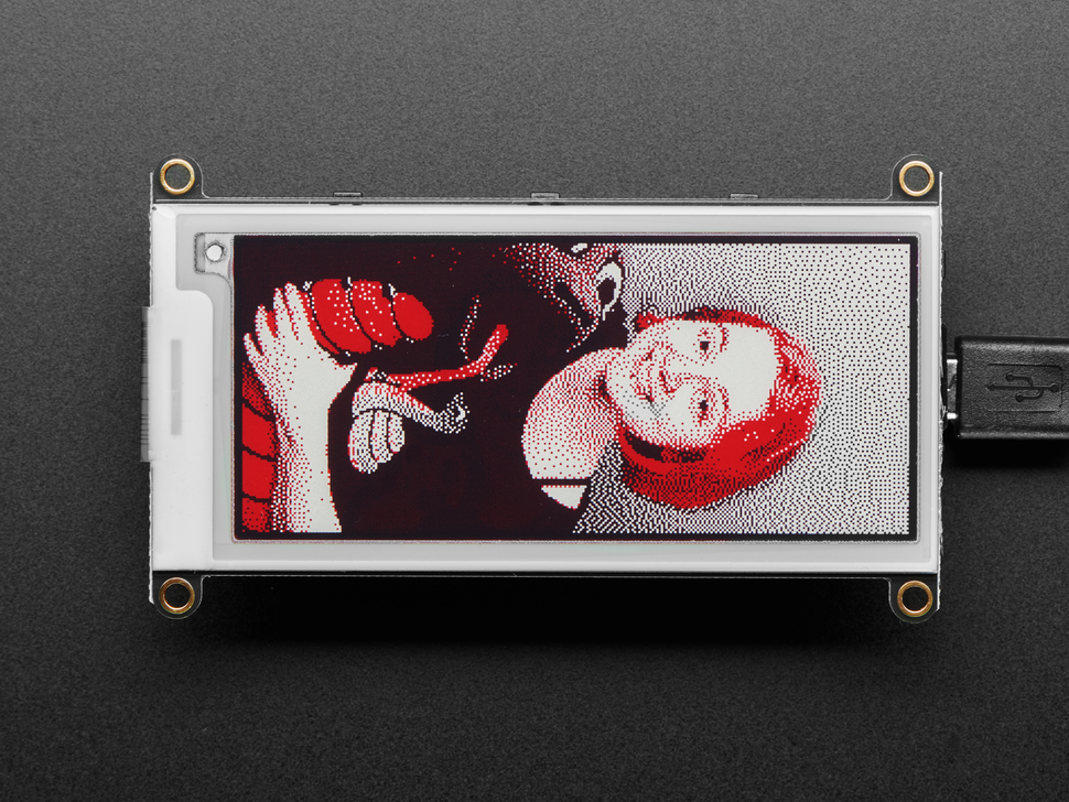 E-Ink display connected to Feather,  with image of lady ada with puppet