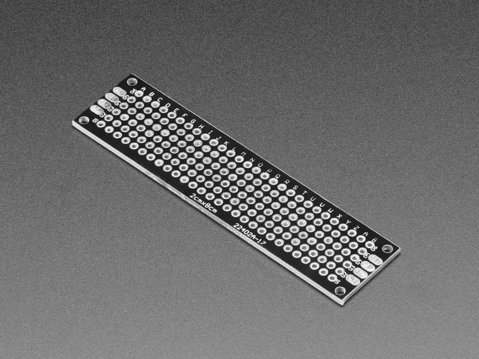 Angled shot of single Universal Proto-board PCB 2cm x 8cm