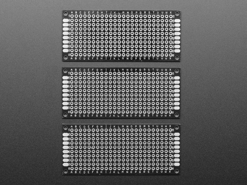 Top view of three Universal Proto-board PCBs 3cm x 7cm