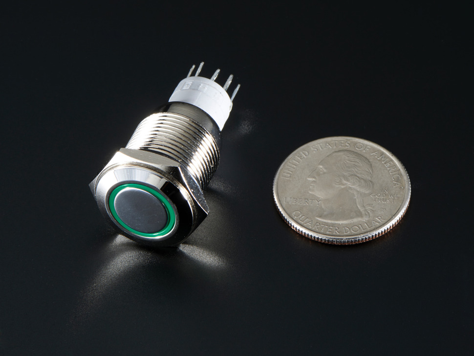 Rugged metal pushbutton with green LED ring next to US quarter.
