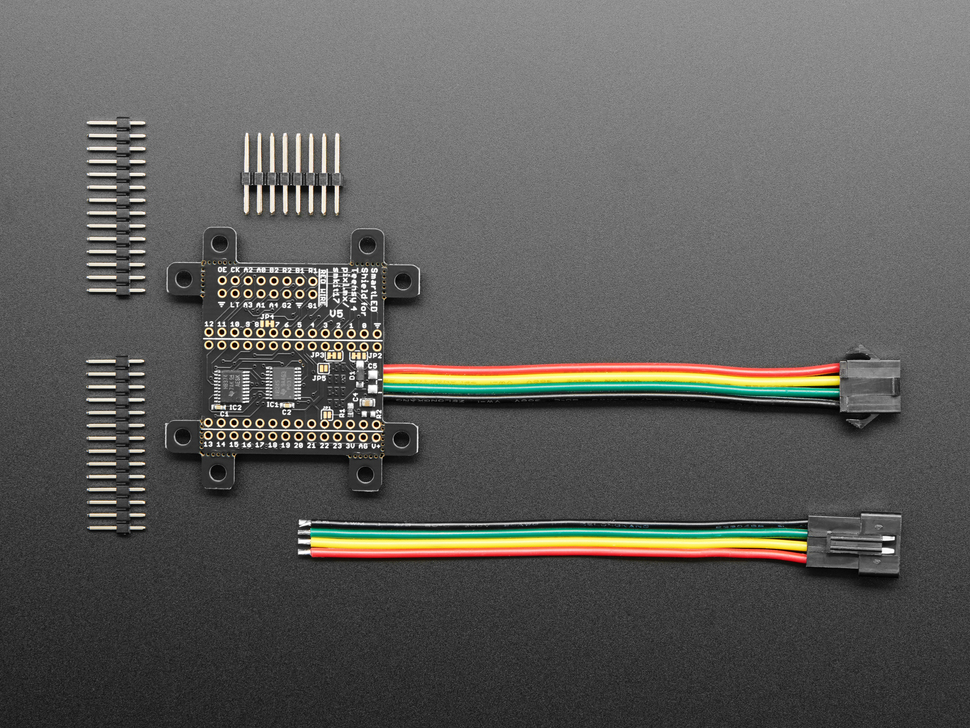 """Top view of SmartMatrix SmartLED Shield along with three pieces of male 0.1"""" header."""