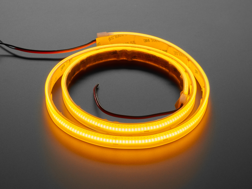 Coiled LED strip lit up yellow