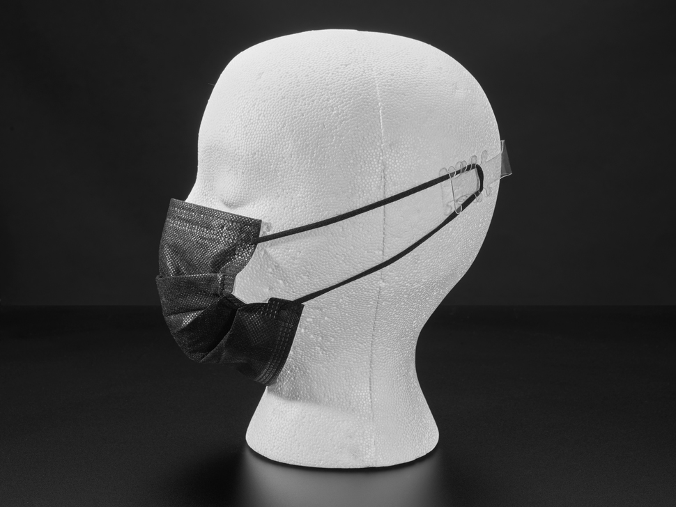 Profile of black surgical style face mask shown on a mannequin