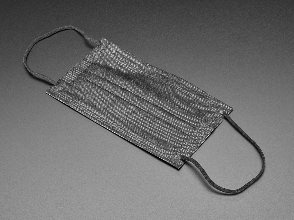 Black surgical style face mask shown laying flat
