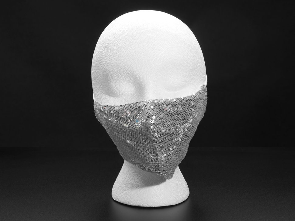 Silver sequined fabric face mask shown on a mannequin