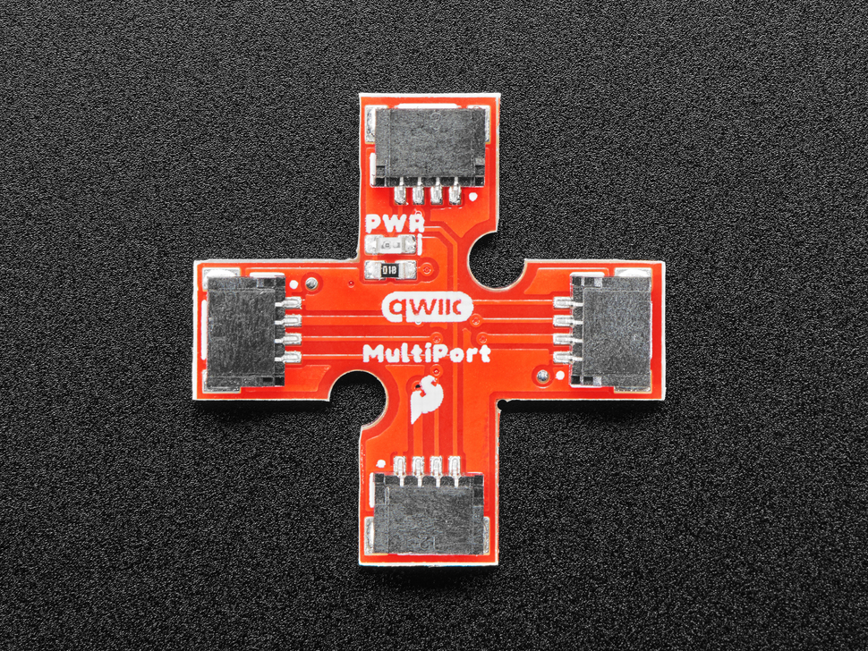 Top down showing a cross shaped PCB with 4 QT ports