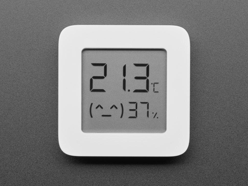 Front of sensor showing LCD display with temperature and humidity plus a happy face on it.