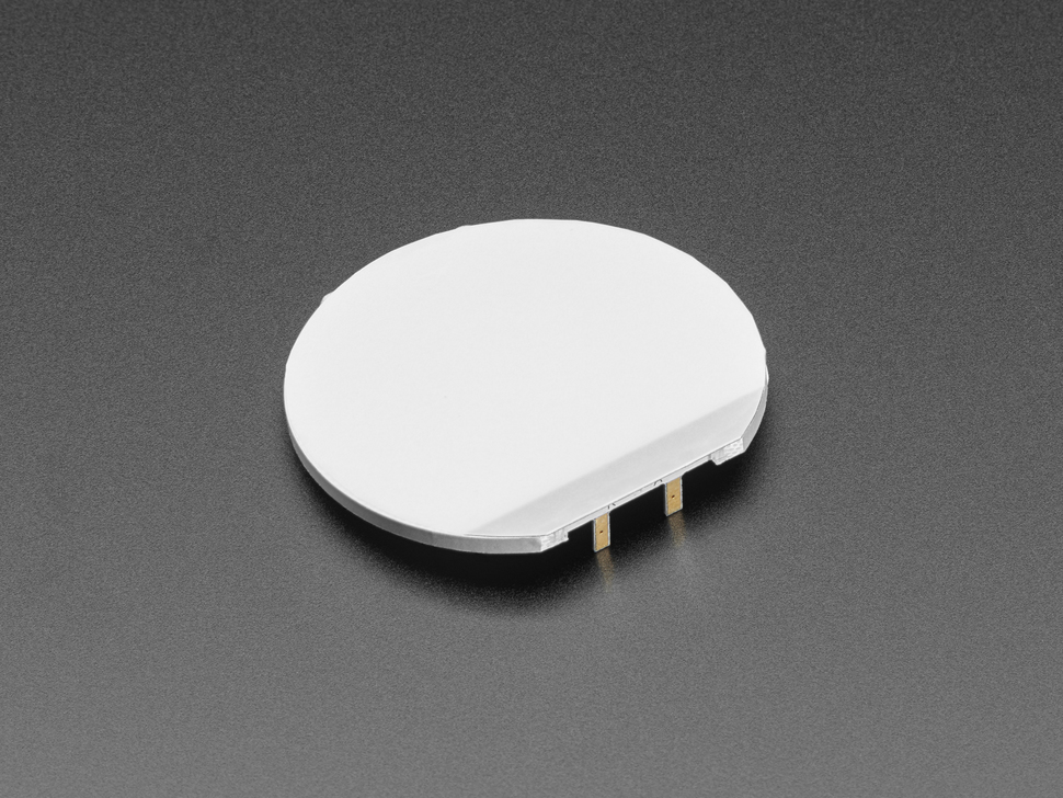 Angled shot of 50mm diameter round backlight LED module.