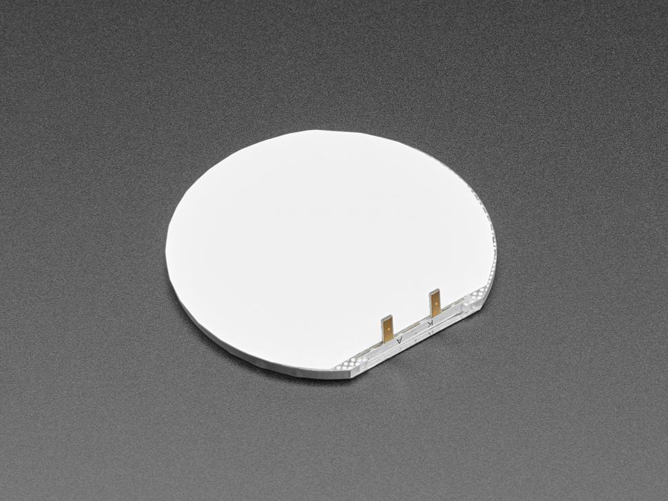 Reverse angled shot of round backlight LED module.