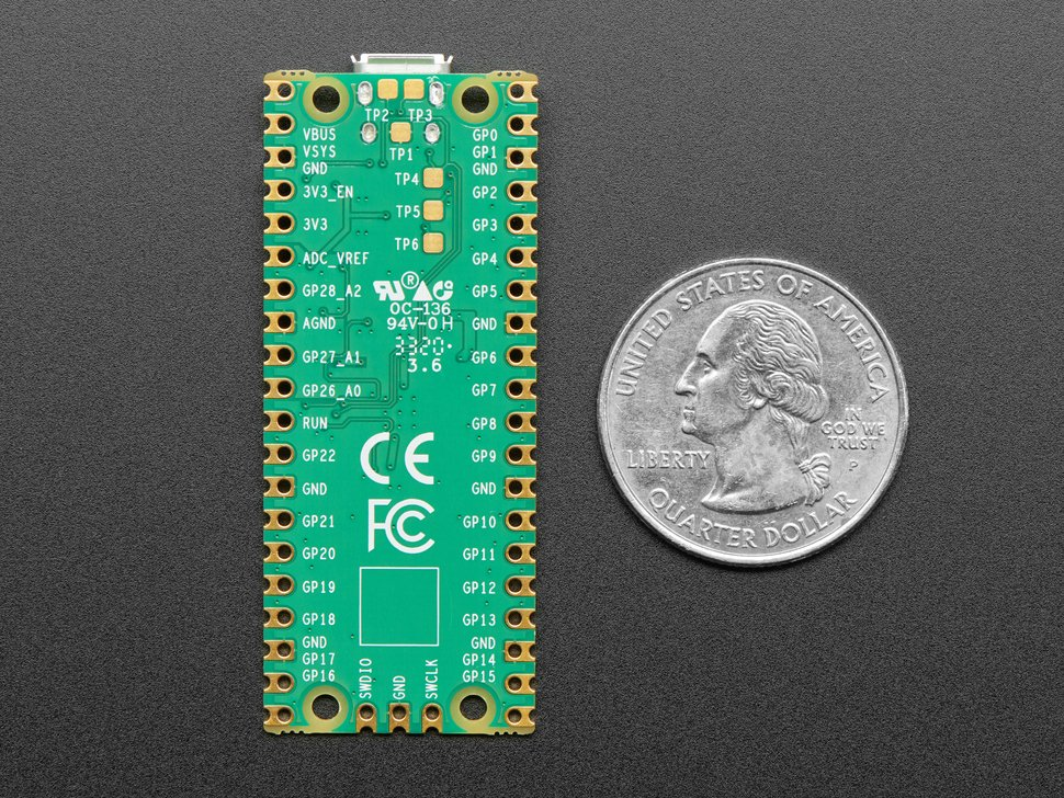 Bottom of PCB with CE and FCC marks, next to US quarter.