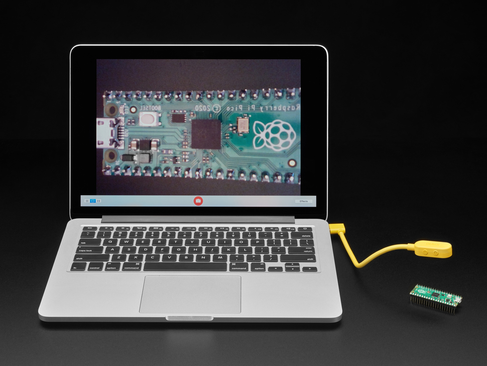 Laptop with kano cam plugged in, pointed at Pi Pico board. Pico is displayed on laptop screen