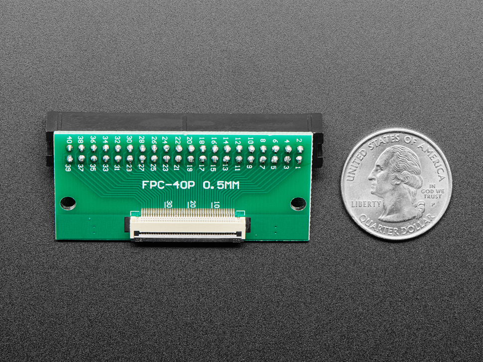 Back of FPC adapter board next to US quarter.