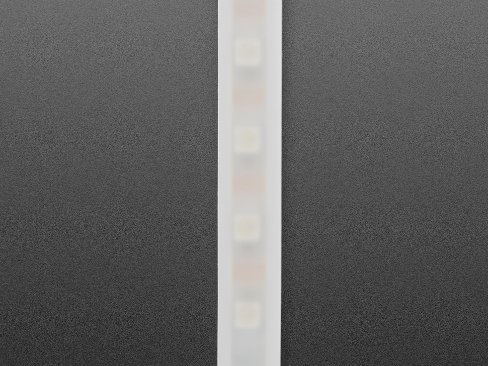 Vertical close-up of LED strip with translucent white sheathing. The LEDs are almost visible.