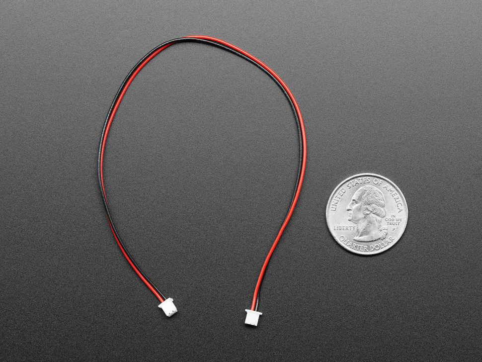1.25mm pitch 2-pin 20cm long cable next to US quarter.