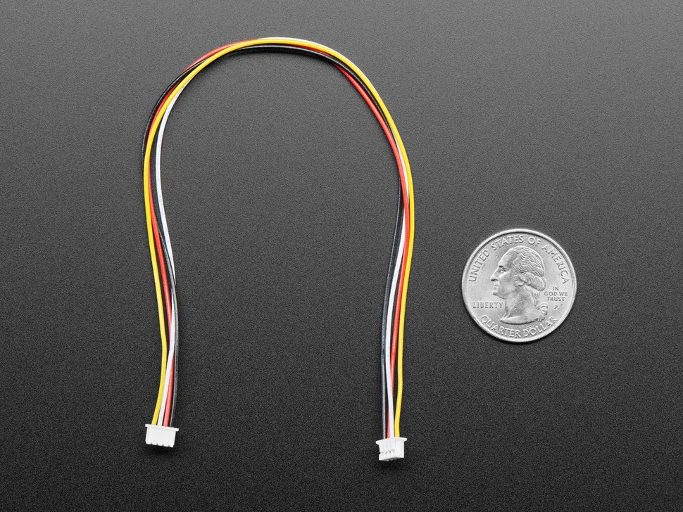 1.25mm pitch 4-pin cable on top of a US quarter.