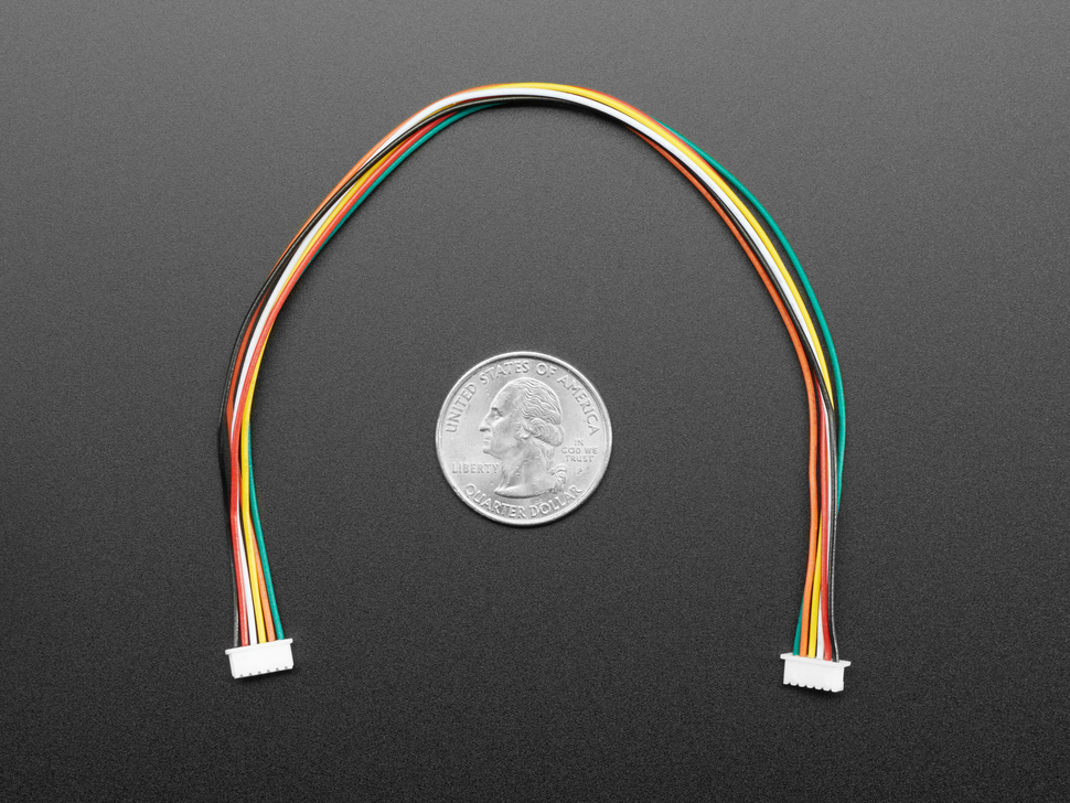 1.25mm Pitch 6-pin Cable 20cm long above a US quarter for scale.